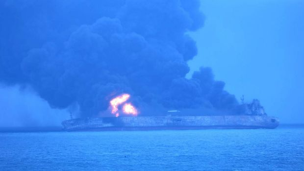 In this photo provided by Korea Coast Guard, the Panama-registered tanker Sanchi is seen ablaze after a collision with a ...