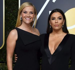 Time's Up leads Reese Witherspoon (left) and Eva Longoria arrive at the 75th annual Golden Globe Awards.