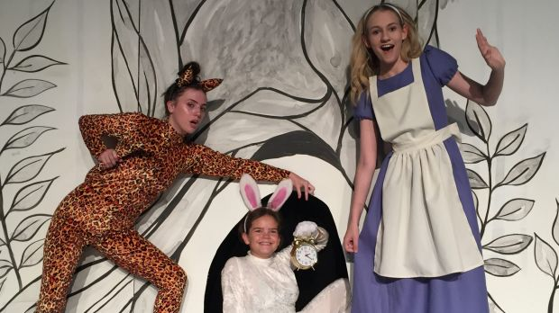 Nicole Carr as the Cheshire Cat, left, Jade Breen as the White Rabbit, Sarah O'Neill as Alice in Ickle Pickle's Alice in ...