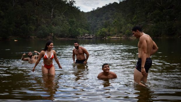Friends from Liverpool cool off at Bents Basin near Warragamba on Monday.