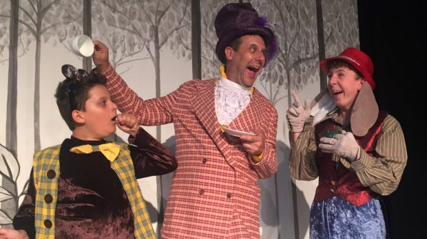 William Best, left, as The Dormouse, Jim Adamik as The Mad Hatter, and Oliver Johnstone as The March Hare in Ickle ...