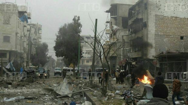 Members of the Syrian civil defense known as the White Helmets, gathering at a street which was attacked by Russian ...