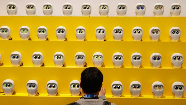 The eyes have it: Book reading robots at the International Consumer Electronics Show in Las Vegas.