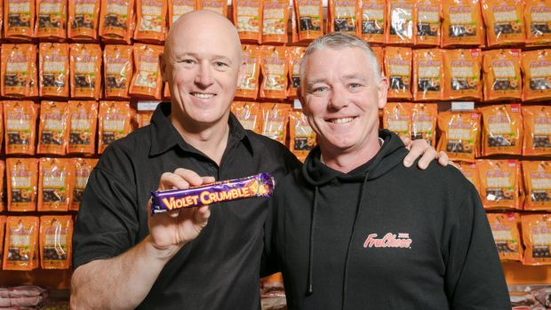"Robern Menz CEO Phil Sims, left, with Richard Sims, said: ""As the new gatekeeper of Violet Crumble, we are aware of the ..."