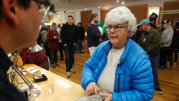 Margot Simpson becomes among the first people to buy marijuana at the Harborside dispensary in Oakland, California, on ...