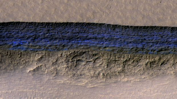 A thick sheet of ice on Mars, photographed by a NASA orbiter, appears bright blue in this enhanced-colour view.