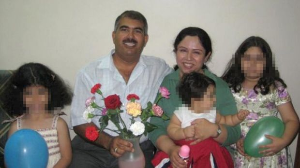 Baha'i man Hamed bin Haydara - here with his family - has been sentenced to death by a Yemeni court on charges of spying ...