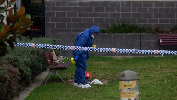 Police set up a crime scene in a park next to Hurstville train station.