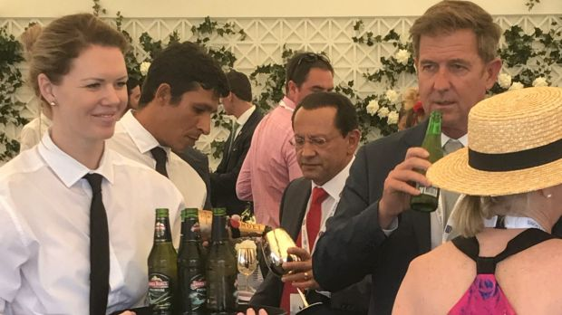 Channel Seven CEO Tim Worner, right, enjoys a drink at the Magic Millions.