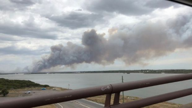 Views from Stockton Bridge of smoke rising from the bushfire which is moving east towards Newcastle Airport.