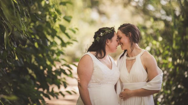 Sally and Kara Bromley share a loving moment on their wedding day.