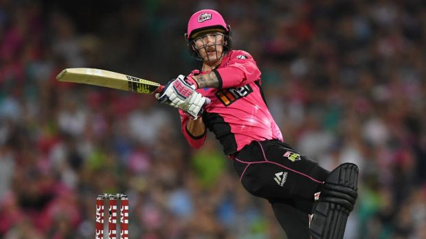 Nic Maddinson hits a six for the Sydney Sixers in their Big Bash derby with Sydney Thunder at the SCG on Saturday night.