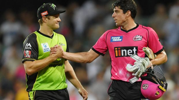 Shane Watson, of the Thunder, congratulates Moises Henriques after the Sixers claimed a thrilling victory at the SCG on ...
