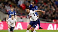 Tottenham Hotspur's Mousa Dembele and Everton's Yannick Bolasie, back, battle for the ball during the English Premier ...
