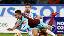 West Ham United's Manuel Lanzini, front, is challenged from Huddersfield Town's Tommy Smith during the English Premier ...