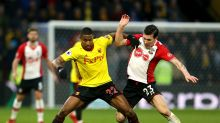 Watford's Marvin Zeegelaar, left, and Southampton's Pierre-Emile Hojbjerg battle for the ball during the English Premier ...