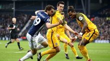 West Bromwich Albion's Jay Rodriguez, left, battles for the ball with Brighton & Hove Albion's Lewis Dunk and Gaetan ...