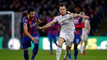 Crystal Palace's Luka Milivojevic, left, and Burnley's Ashley Barnes battle for the ball during the English Premier ...