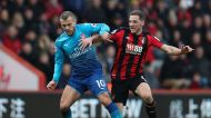 Arsenal's Jack Wilshere, left, holds off Bournemouth's Dsan Gosling during the English Premier League soccer match at ...