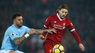 Manchester City's Kyle Walker, left, and Liverpool's Adam Lallana vie for the ball during the English Premier League ...