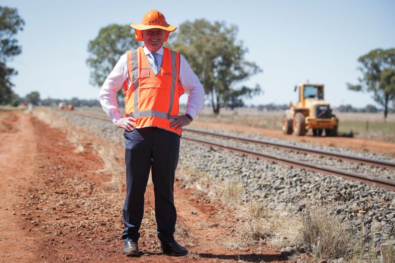 Deputy Prime Minister and Minister for Infrastructure and Transport Barnaby Joyce poses for photos as he visits the site ...