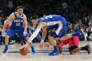 Philadelphia 76ers guard Ben Simmons recovers a loose ball from Toronto Raptors guard Kyle Lowry.