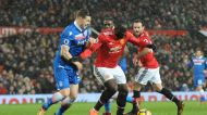 Manchester United's Romelu Lukaku, right holds off the challenge of Stoke City's Kevin Wimmer as he turns to shot and ...