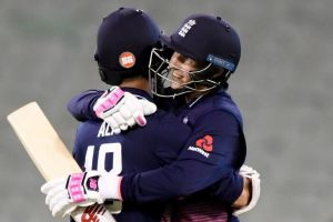 Victory at last: Moeen Ali and Joe Root enjoy a win in Melbourne.