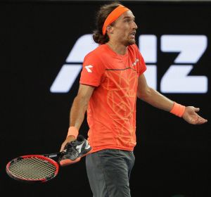 Footloose: Ukraine's Alexandr Dolgopolov gestures to the umpire after his shoe came off during his second round match ...