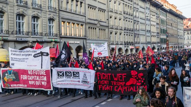 Protesters in Bern, Switzerland demonstrate against the World Economic Forum and US president Donald Trump's visit.
