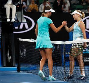 Elise Mertens of Belgium, left, shakes hands with Australia's Daria Gavrilova.