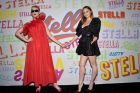 Stella McCartney and Katy Perry pose on the media wall at McCartney's autumn 2018 collection.