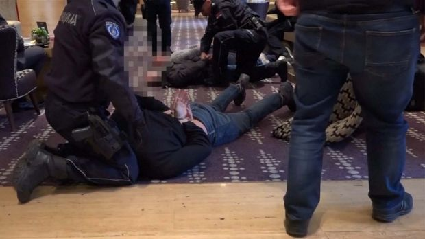 Police detain three Australian men on the ground of the five-star Metropol Palas Hotel in Belgrade.
