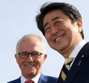 Australian Prime Minister Malcolm Turnbull and Japanese Prime Minister Shinzo Abe inspect the Patriot Missile system and ...