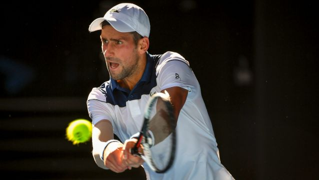 Novak Djokovic struggled in the heat early with 10 unforced errors in the first three games.