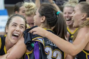 Melbourne Boomers celebrate their game-two win over Townsville Fire that has set up a decider in Townsville on Sunday.