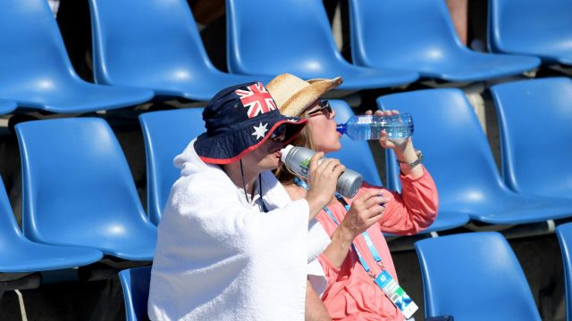 Tennis goers do their best to keep cool.