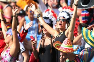 Party crowd: Sevens fans sing in the sunshine at Allianz Stadium.