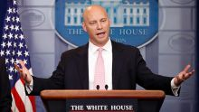 Director of the Office of Management and Budget Mick Mulvaney, left, stands as Marc Short, White House director for ...