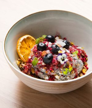 Chia pudding with freeze-dried raspberries, maple buckwheat and fruit.