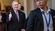 Senate Majority Leader Mitch McConnell, R-Ky., signals a thumbs-up after a vote to reopen the government passed at the ...