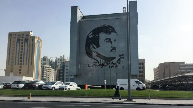 The face of the Emir on a building in Doha, Qatar. Qatari are showing solidarity with the government for withstanding ...