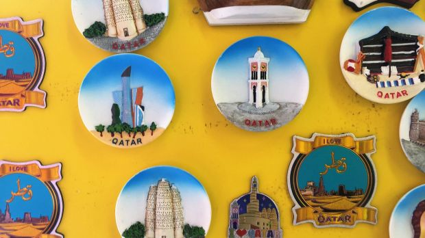 Magnets for sale at a tour agency office in Qatar.