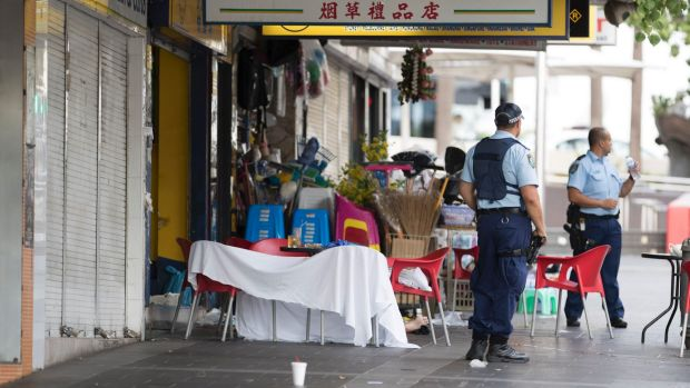 Police guard the crime scene where the criminal lawyer was shot dead.