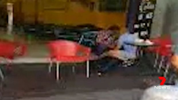 CCTV vision of two people attending to the lawyer's body at Bankstown.