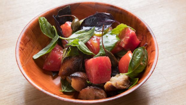 Sourdough croutons are smoked for a juicy tomato panzanella salad.