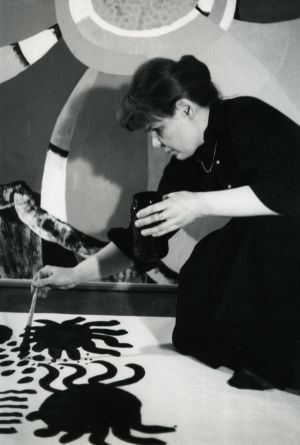 Maija Isola painting one of her bold patterns in the 1960s.