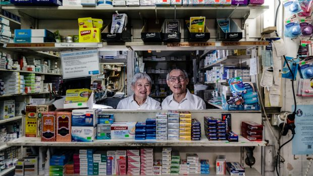 Nang and Jin Wu, who have owned and worked at the same pharmacy on George Street for 40 years.