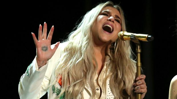 Kesha performs <i>Praying</i> at the 60th annual Grammy Awards.
