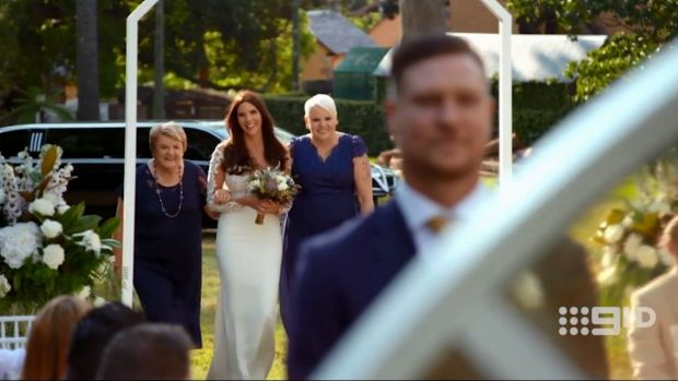Tracey comes down the aisle with both her mothers on Married At First Sight.
